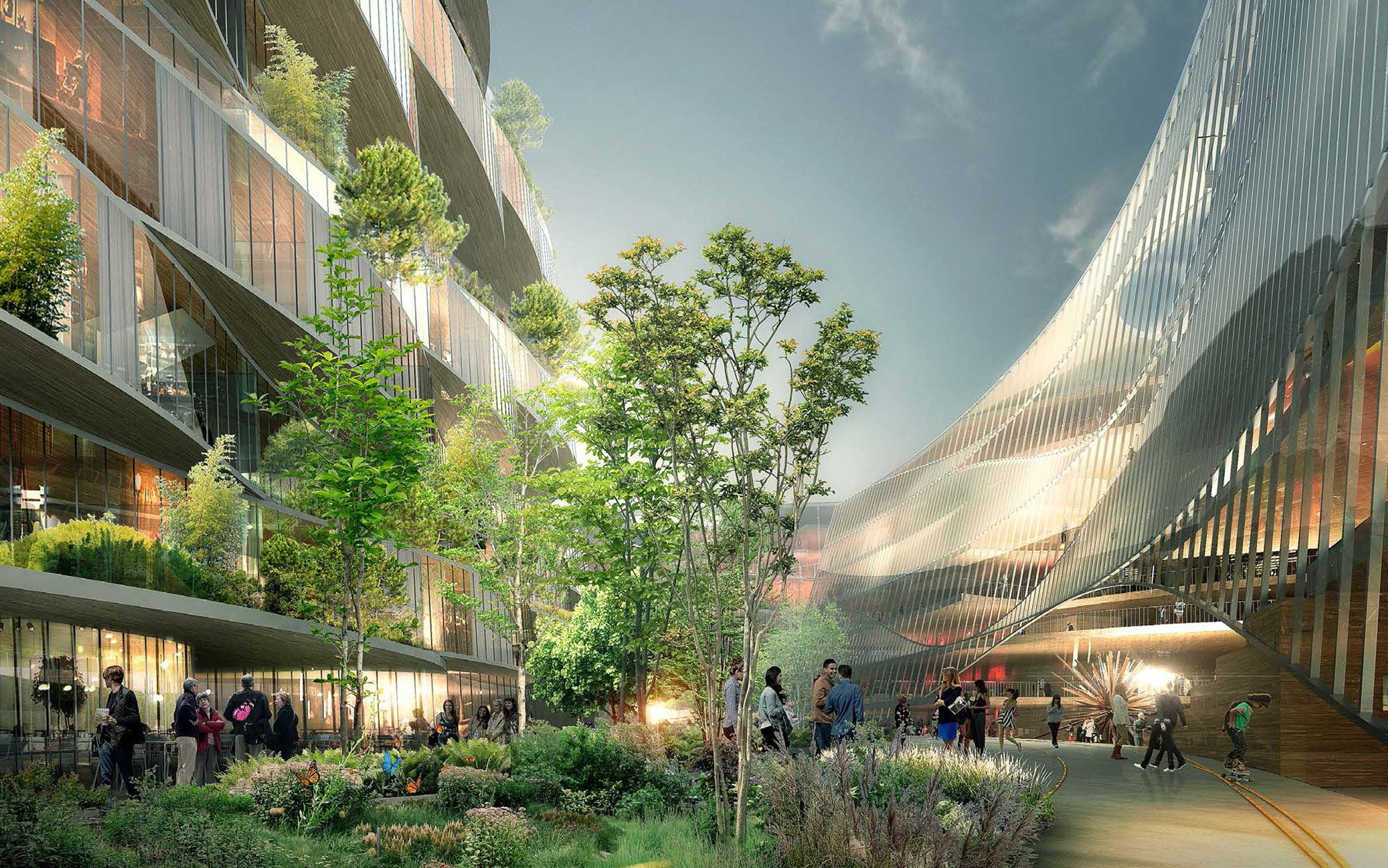 Vue perspective depuis la promenade à l´intérieur de l´ilot avec à droite l´entrée depuis l´Atrium centrale des bureaux 1 et à gauche les logements.